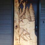 Carved door with wolf