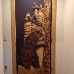Carved door with bear